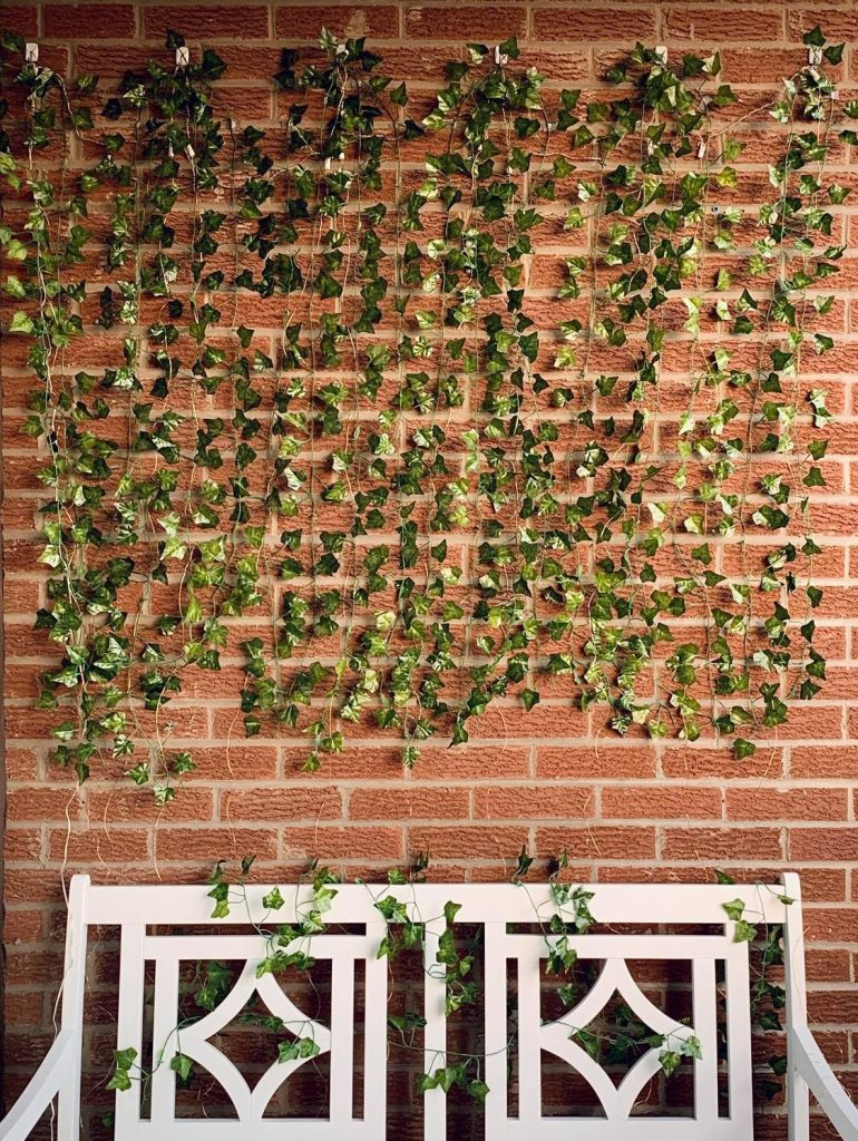 Decorate your balcony with fake foliage like this ivy wall